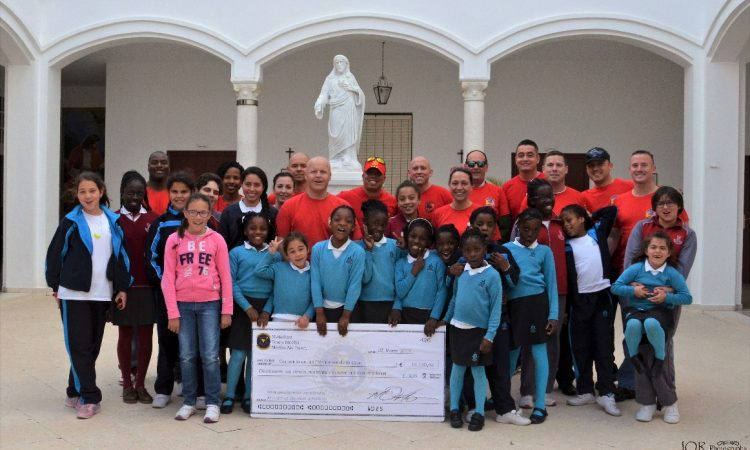 The Orphans (our mini-matadors) from the Sisters of the Cross Convent hold a check for 19,140.42 euros. Donated funds will be used to pay for school uniforms and future orphanage expenses. (Capt Jose Quintanilla courtesy photo)